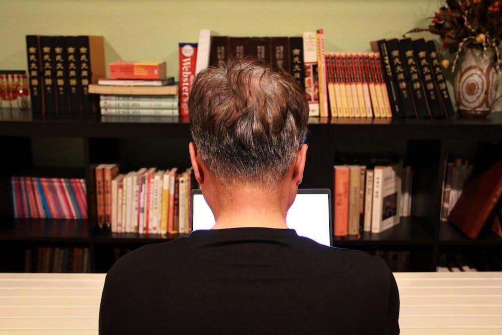 professor-online-virtual-instruction-teaching-bookshelf