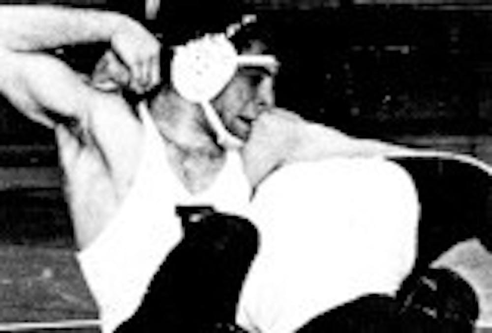 3-19-2969-wrestling-dave-pottruck-dp-archives