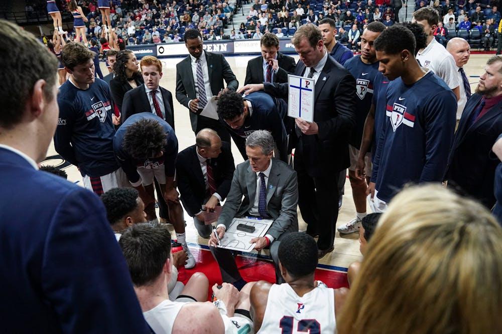 coach-steve-donahue-and-mens-basketball-team-huddle