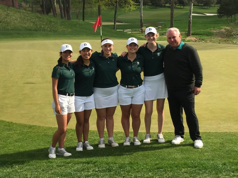 Kristen Chen '22, Moon Cheong '21, Kaitlyn Lees '22, Maddie Nelson '20 and Catherine Roddy '19 pose with Kirk following the Big Green's second place finish at the Ivy League Championship in 2019.