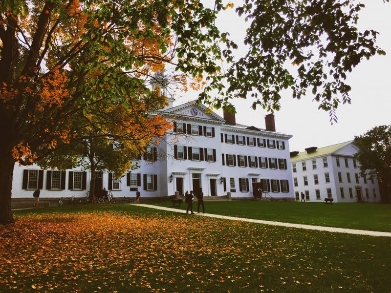 Dartmouth Hall is surrounded by fall leaves.