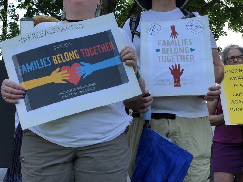 Community members held signs as theygathered on the Green to protest theTrump administration's immigration policies.
