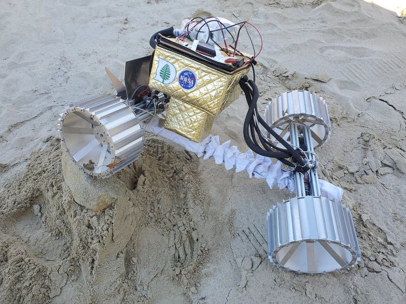 The rover takes on tough terrain in a sand pit in professor Laura Ray's yard.