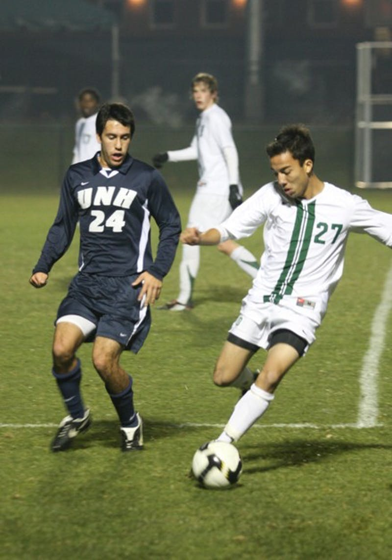 Andrew Olsen '11 notched the game-winning goal eight minutes into overtime as the Big Green outlasted UNH, 2-1.