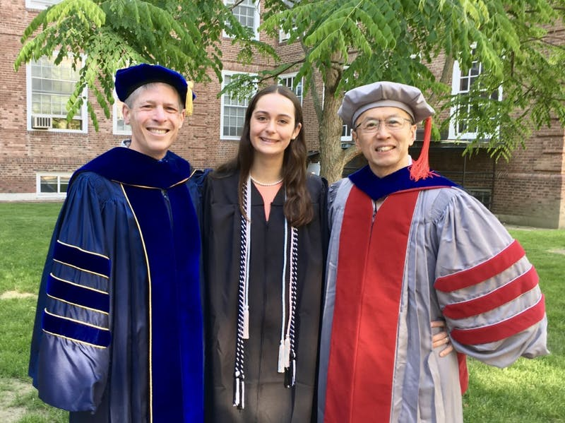 From left to right: John Carey, Katherine Clayton '18 and Yusaku Horiuchi co-authored the book.