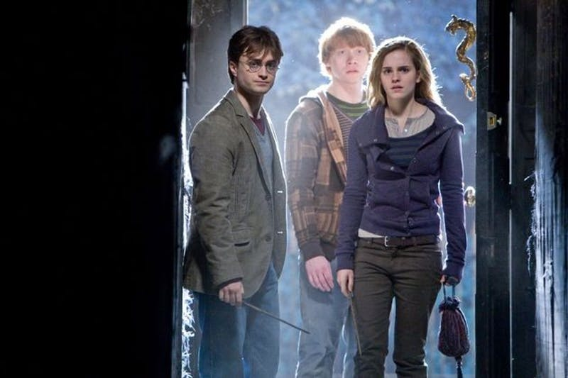 HPDH1-00168(L-r) DANIEL RADCLIFFE as Harry Potter, RUPERT GRINT as Ron Weasley and EMMA WATSON as Hermione Granger in Warner Bros. Pictures