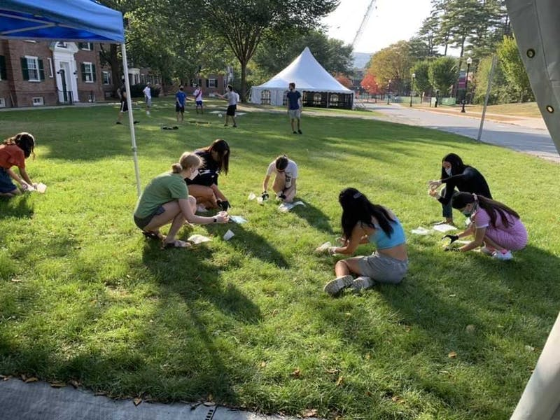 Students tie-dye masks at a Programming Board event on Sept. 26.