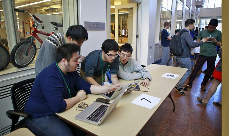 College students worked on projects at the hackathon this weekend