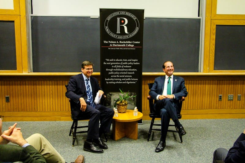 Azar, seated right, engaged in a discussion at the Rockefeller Center with professor Charlie Wheelan.