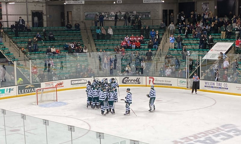 The Big Green celebrates after defeating Boston University 5-4 on Saturday.
