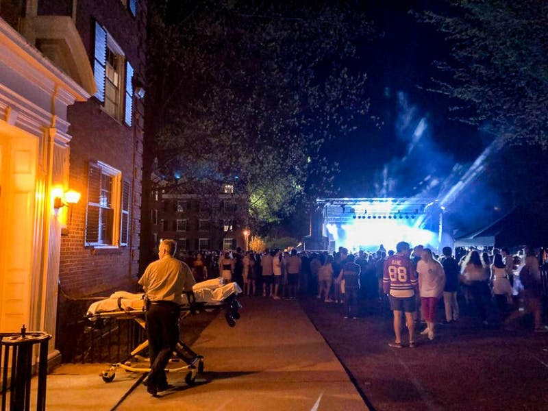 A security officer waited outside Gile Hall with a stretcher during the main Green Key concert last Friday night.