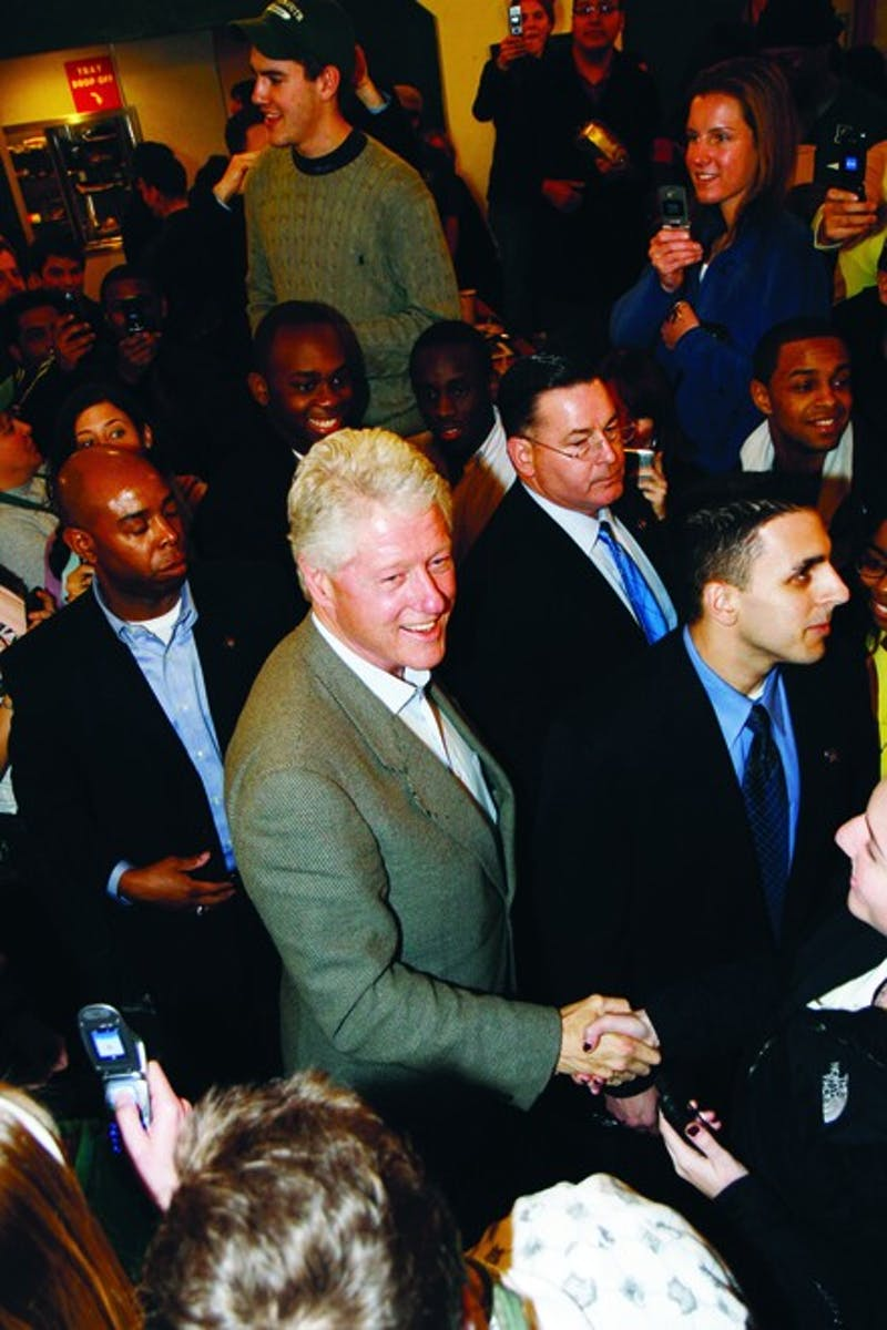 Former President Bill Clinton greets students during an impromptu visit to Food Court following his Monday speech in support of wife Hillary.