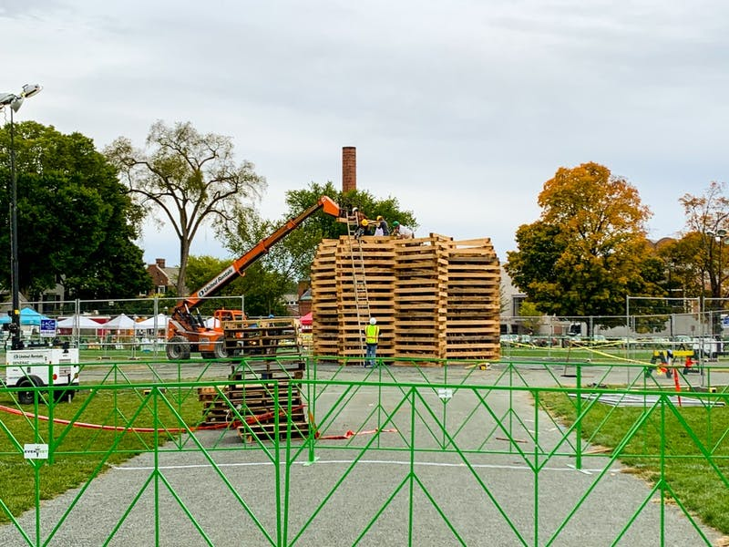 A construction crew worked on the Homecoming bonfire Wednesday afternoon.