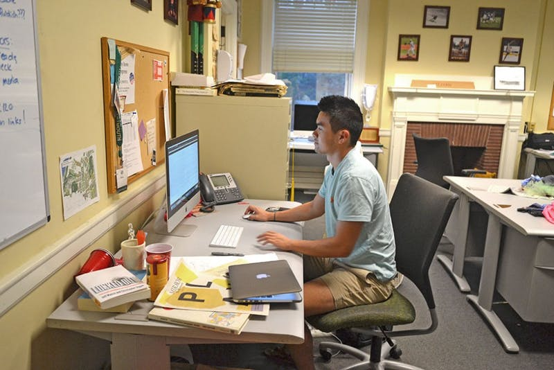 Ray Lu '18 works on a computer at The D's office.
