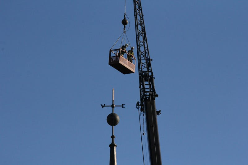 Construction workers removed the weather vane atop Baker Tower last Thursday morning.
