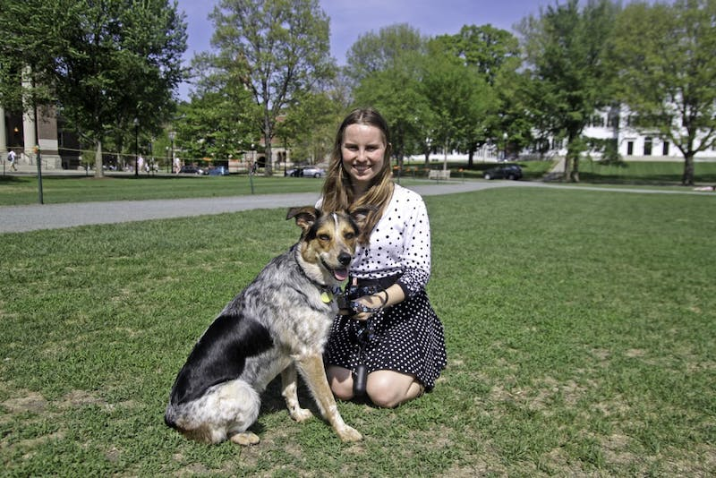 Allie Fudge '18 hangs out with her support dog, Kelsie Iris, on the Green.