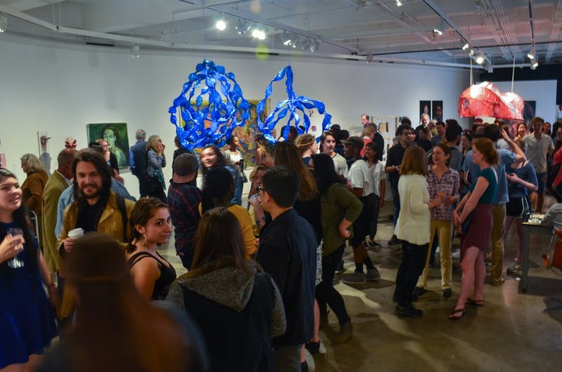Many students and faculty members attended the opening reception of the studio art department's senior majors exhibition.