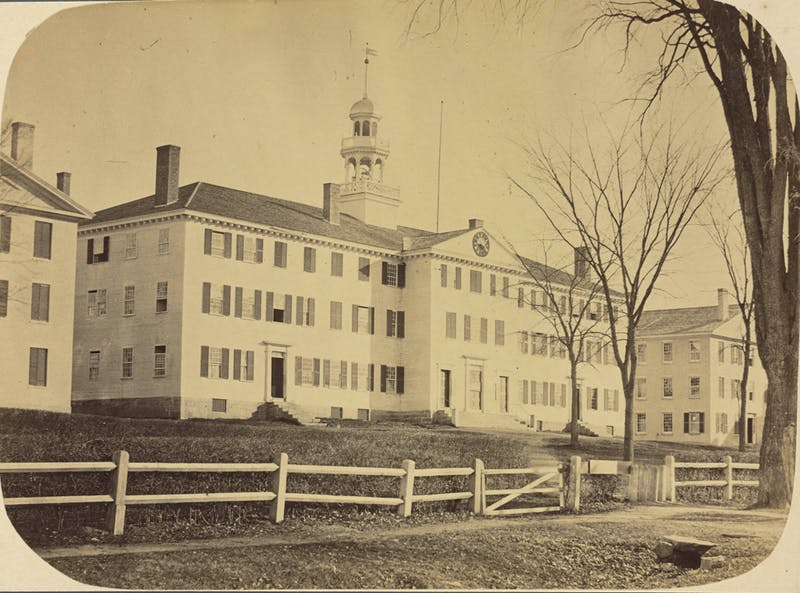 An archival photograph shows an earlier iteration of Dartmouth Hall in 1867.