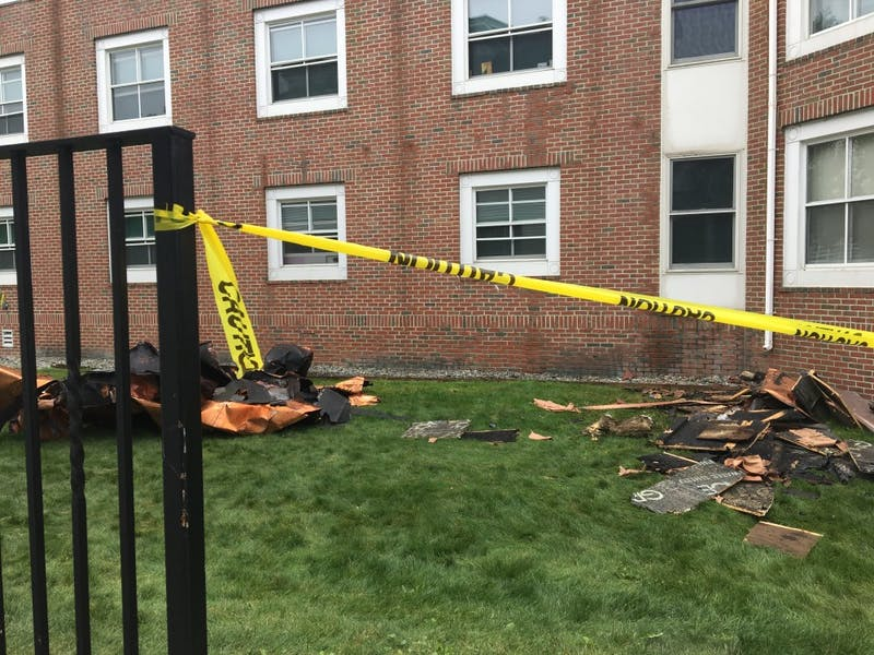 Pieces of Morton Hall roof on the ground Saturday afternoon.