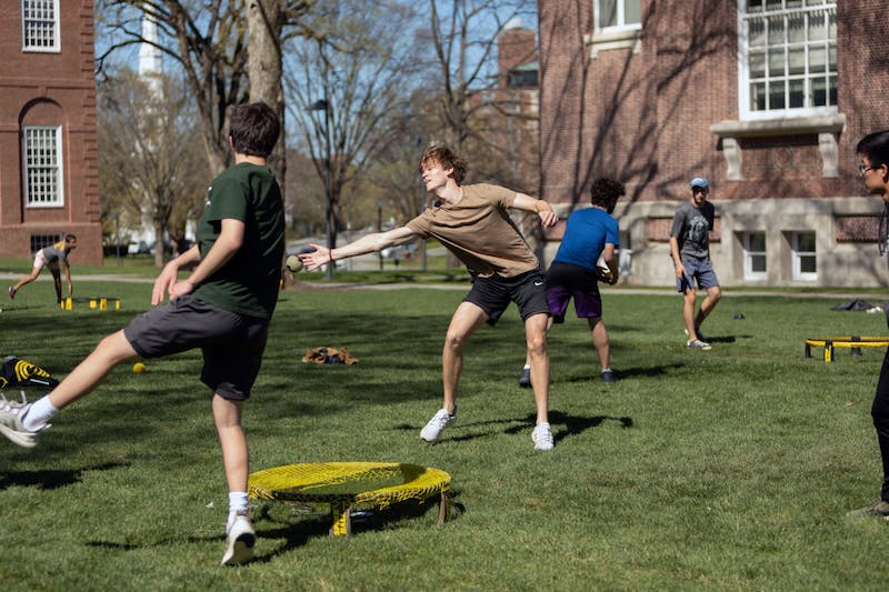 Students participating in a spike ball competition on the Green.