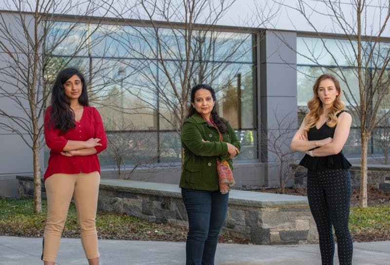 The team that won the top prize consisted of Geisel neurology professor Arti Gaur, middle, and Guarini students Divya Ravi, left, and Jordan Isaacs, right.