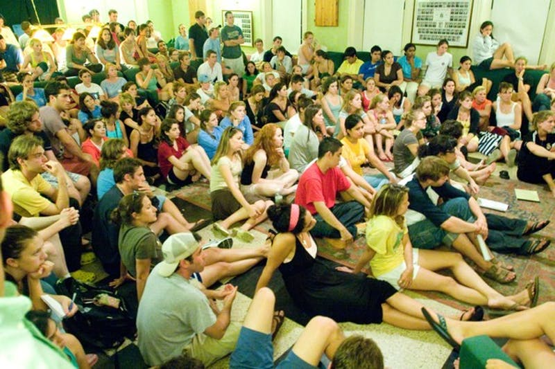 Students crowd Gamma Delta Chi fraternity's chapter room Tuesday to discuss gender issues on campus.