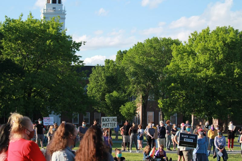 Community members maintained social distancing as they gathered on the Green to protest police brutality on Saturday.