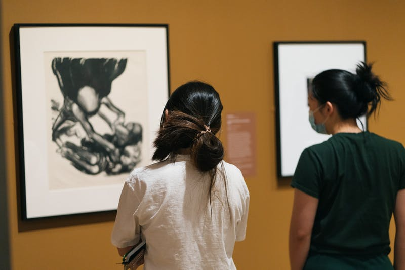 Students visit Cochran's exhibit, which is currently on view.