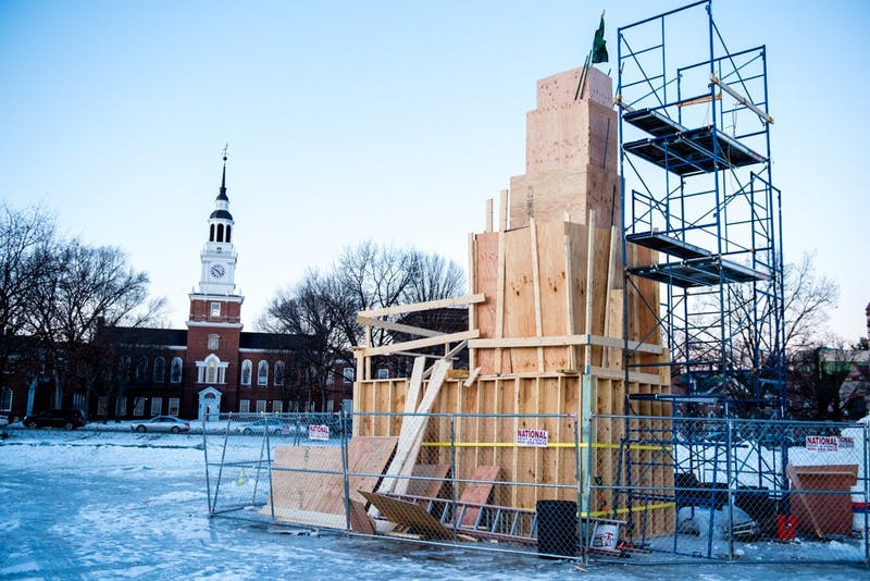 Wood planks keep the true identity of this year's snow sculpture a secret.