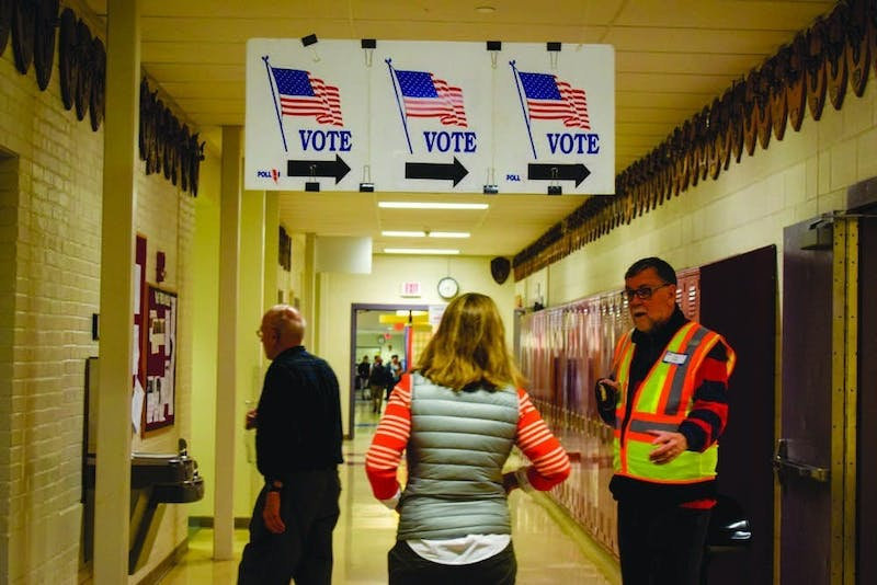 Voters arrive to cast ballots at Hanover High School.
