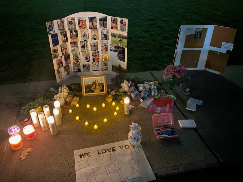 Students created a memorial for Reimer using photos and candles and wrote down notes in memory of her.