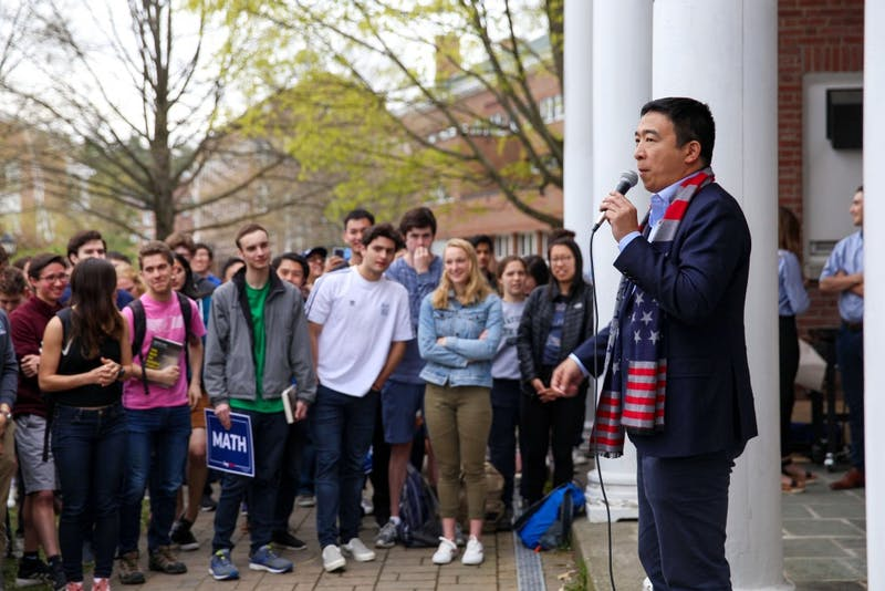 Yang spoke to a crowd of students outside of Beta Alpha Omega fraternity.