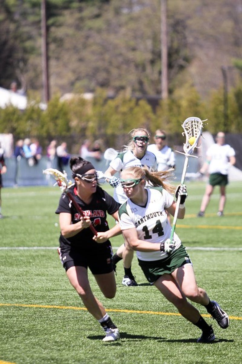 Dana Brisbane '12 was part of the Dartmouth defensive unit that held Cornell University to five goals below its season scoring average in the 12-10 win.
