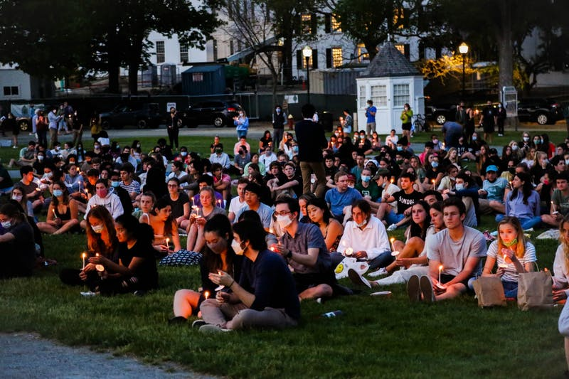 """Students held candles during the candlelight vigil, """"Dartmouth Remembers."""""""