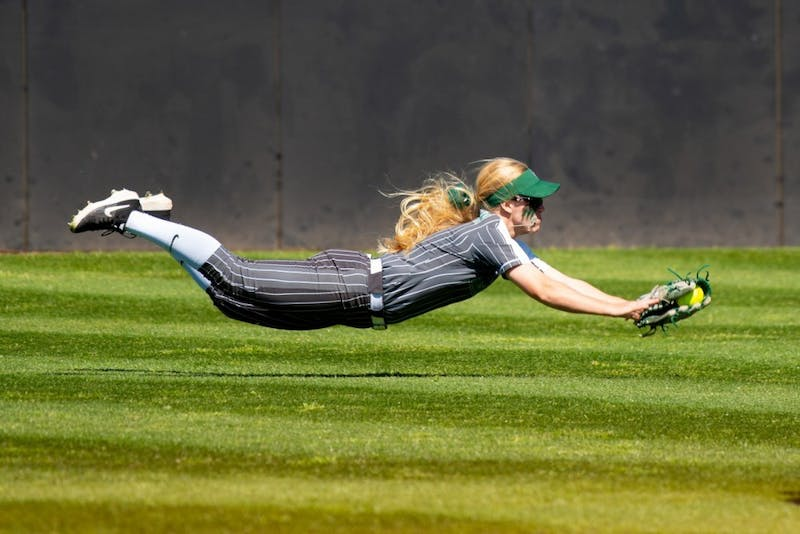 Taylor Ward '19 makes a diving catch against the University of Oklahoma. (Courtesy of the Dartmouth Athletics Department)