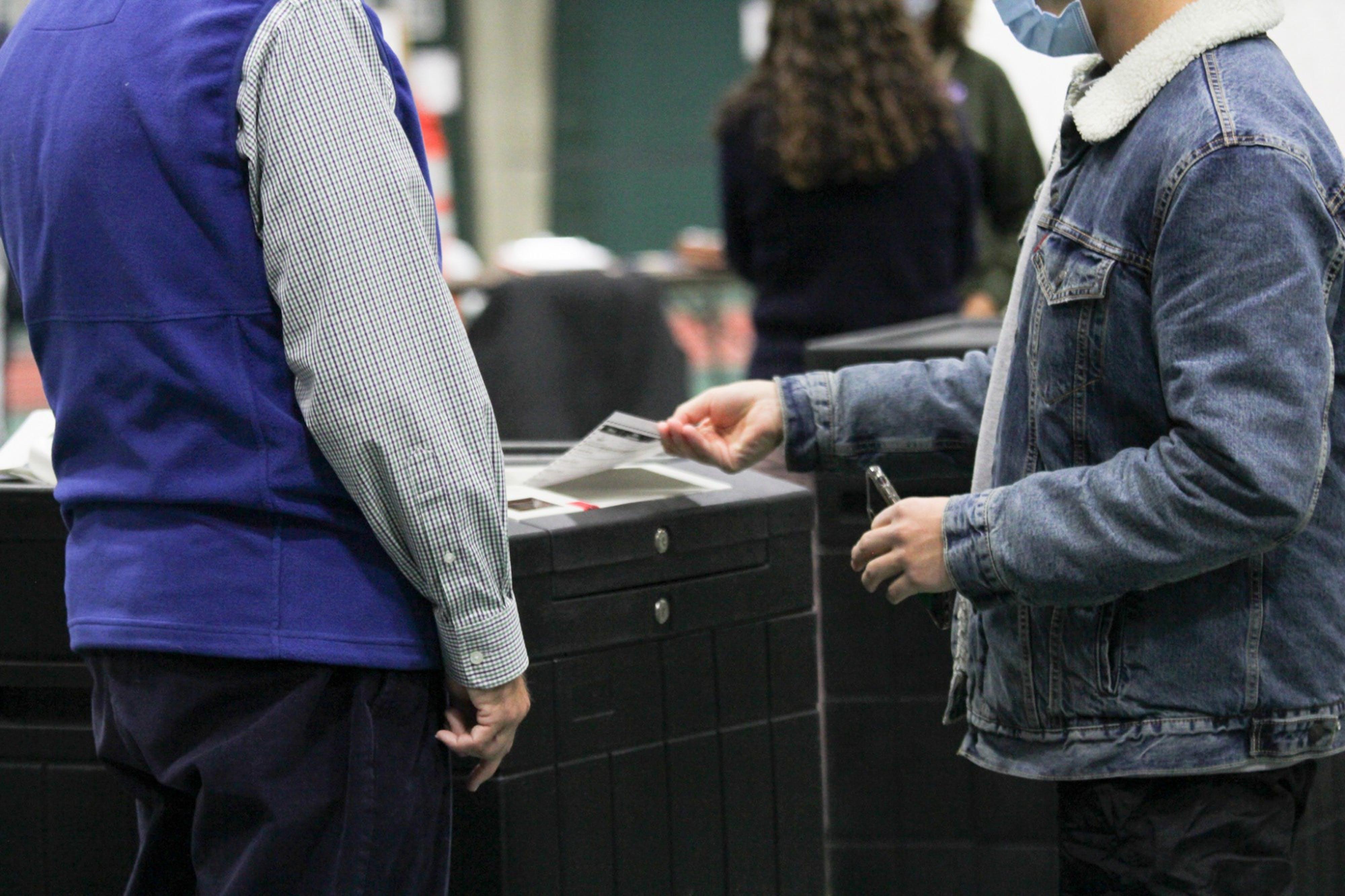 feeding-into-voting-machine