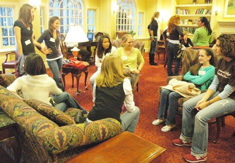 Sophomore girls gather at The Hanover Inn to meet sisters of the newly-created Alpha Phi sorority at rush Wednesday night.