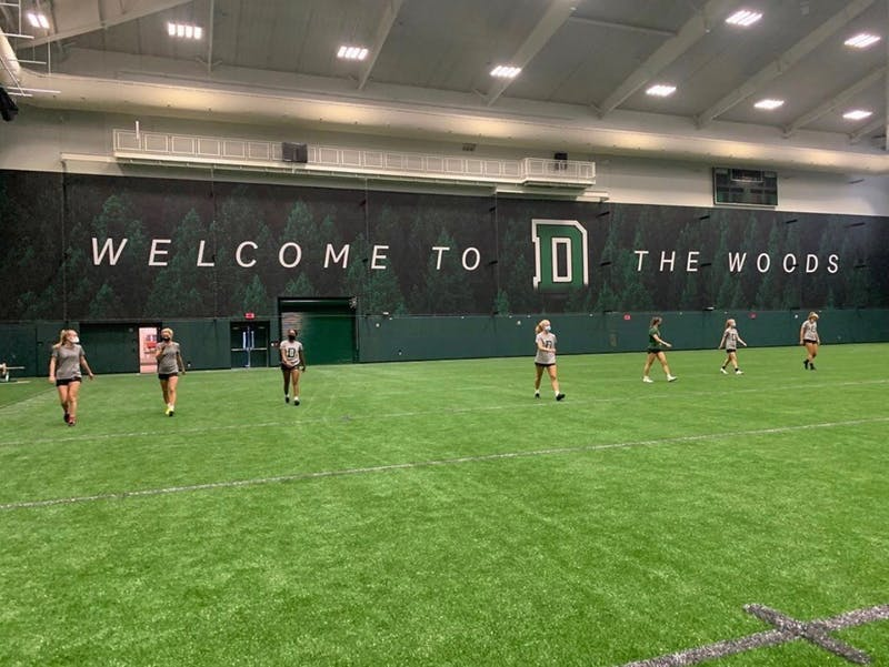 The women's soccer team engages in its first practice in the Indoor Practice Facility.