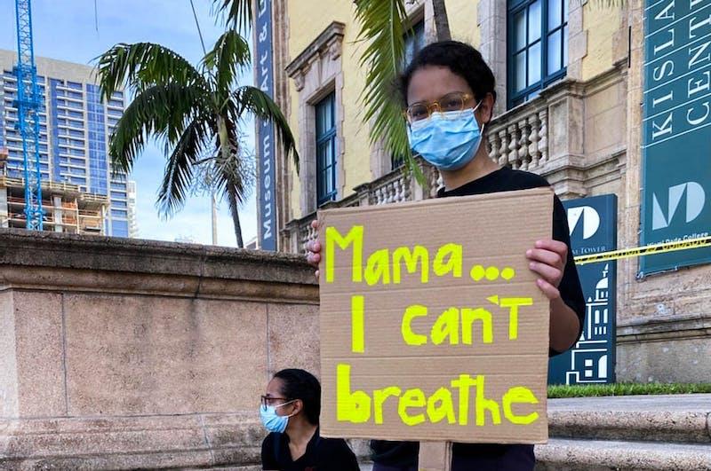 Marina Cepeda '21 and her sister, Maritza Cepeda, protest at Biscayne Boulevard, Miami.