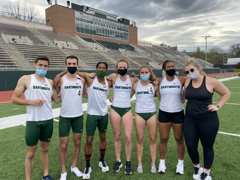 Max Frye '21, MJ Farber '21, Donovan Spearman '21, Camille Landon '21, Kathryn Laskoski '21, Samantha Stevens '21 and Lily Lockhart '21 pose for a picture on Memorial Field during Dartmouth's first home track meet since the COVID-19 shutdown.