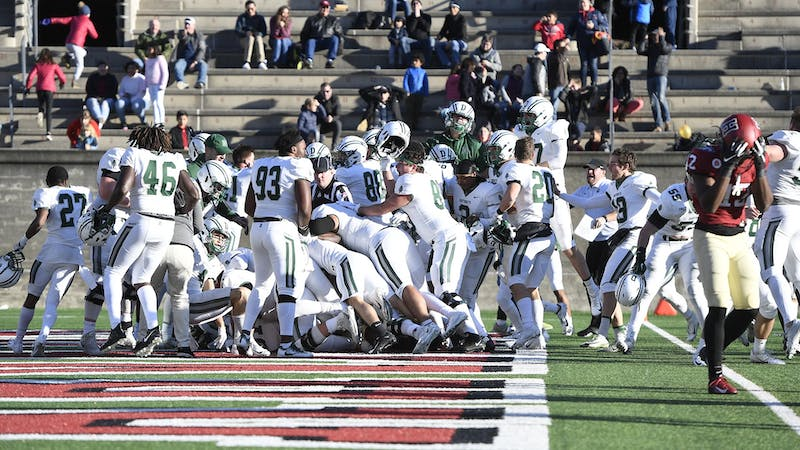 The Big Green celebrate after a successful Hail Mary play which gave it a 9-6 win over Harvard on Saturday.