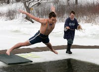 Jon Sheller '09 takes the plunge into a frigid Occom Pond during Winter Carnival's annual Polar Bear Swim, which was held on Friday.