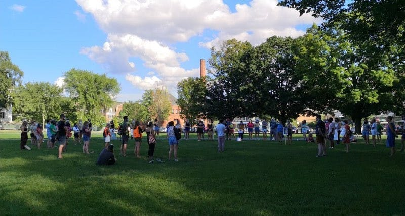 "Students participate in a ""Justice for Maha Hasan"" protest on the Green on July 31."