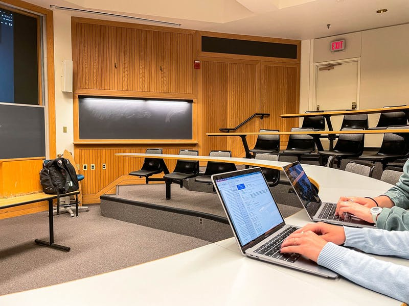 Students gather in lecture halls to attend their in-person classes.