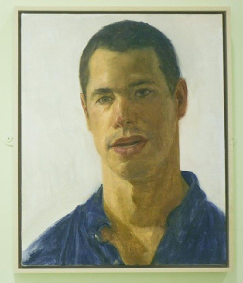 Felix de la Concha's portrait of Andrew Zabel '09 hangs in the main hall of Baker Library.