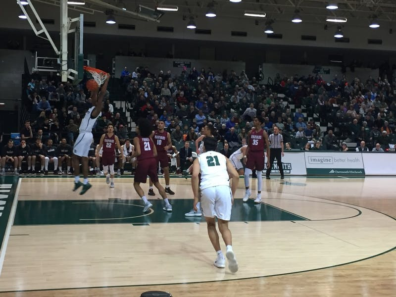 Chris Knight '21 dunked the ball during Dartmouth's 81-63 win over Harvard Saturday night. Knight scored 20 points in the game.
