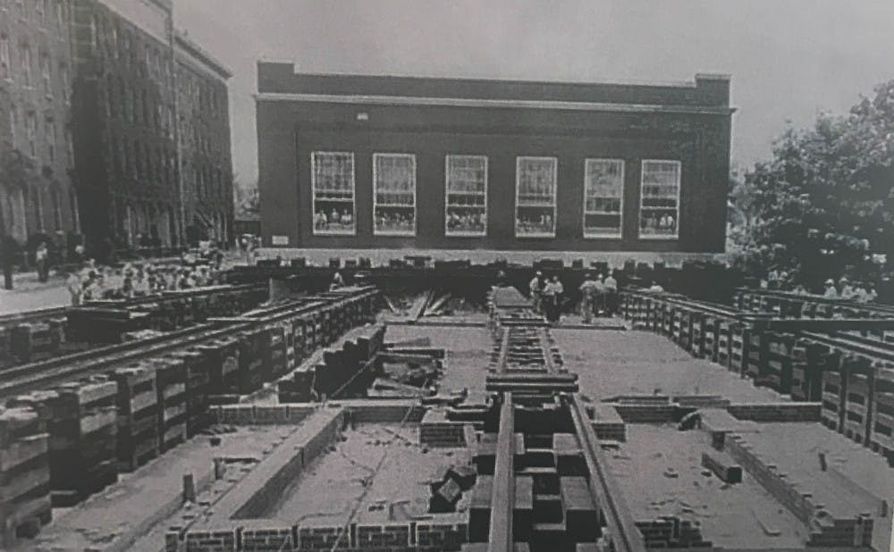 The Liggett & Myers headquarters being rolled across the street in 1946 with employees still inside working.