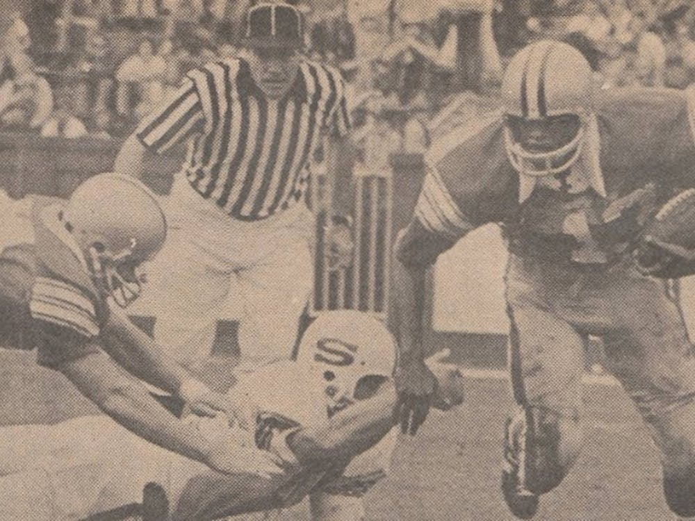 Ernie Jackson earned All-American honors his senior year as a cornerback and tailback, playing both offense and defense.