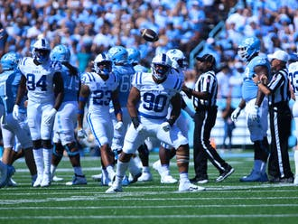 DeWayne Carter (center) led the Blue Devils with 1.5 sacks and two tackles for loss.