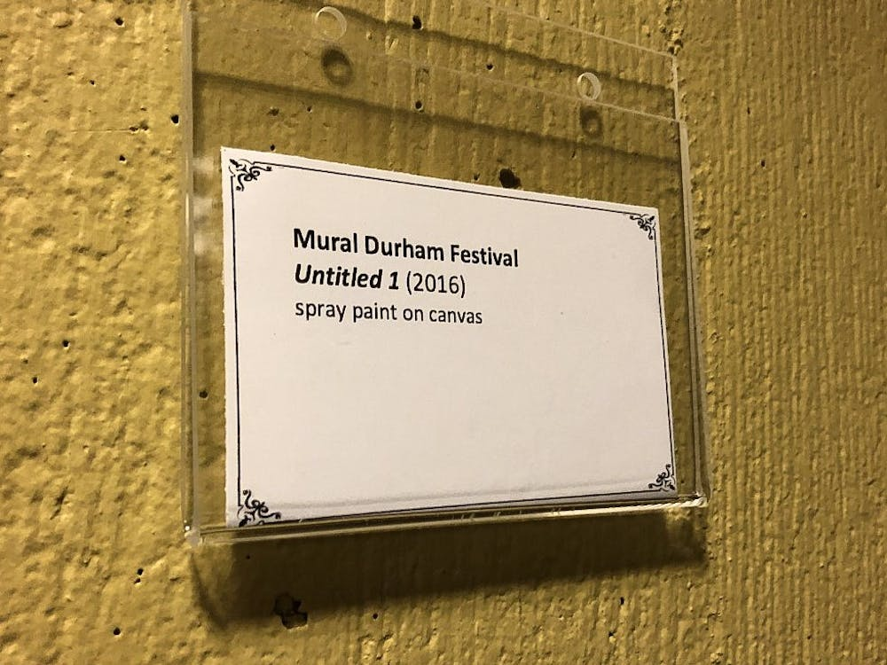 """The placard next to the painting. """"Untitled 1"""" was not actually painted at the Mural Durham Festival."""
